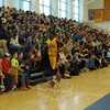 "The Harlem Wizards player James ""Road Runner"" Tyndal ran past audience members on Sunday, February 22, in Newtown High School gymnasium during a Harlem Wizards vs Newtown teachers/staff fundraiser game for the district's PTSA and PTAs. (Hallabeck photo)"