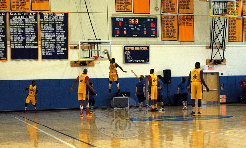 """Harlem Wizards player Roscoe """"Sarge"""" Johnson, Jr, scored on during the February 22 comedy basketball fundraiser event at Newtown High School. (Hallabeck photo)"""