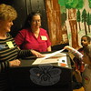 Head O' Meadow kindergartener Ava Geiger cast her vote in her school's annual Vote For Books event on Monday, April 27, with Republican Registrar of Voters JoAnne Albanesi, left, and Democratic Registrar of Voters LeReine Frampton, center, looking on. (Hallabeck photo)