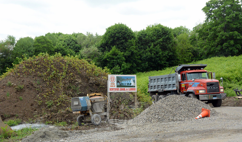 The Borough Zoning Commission is continuing its regulatory review of the Aquarion Water Company's proposal to build a water pumphouse at the 12 Church Hill Road site where Newtown Hook & Ladder Volunteer Fire Company plans to construct a new firehouse. Shown is the firehouse construction site on May 20. (Gorosko photo)