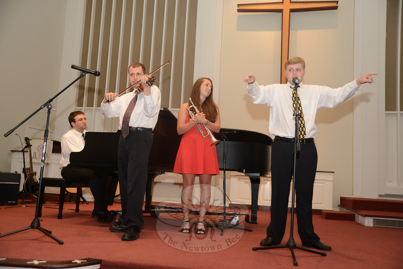 """Entertaining the audience with a playful version of """"Yellow Submarine"""" were, from left, pianist Miles Massicotte, Isaac Ohring on violin, Aimee Alexandra on trumpet, and vocalist Christopher Simon at the third annual benefit concert hosted by Families United in Newtown. (Bobowick photo)"""