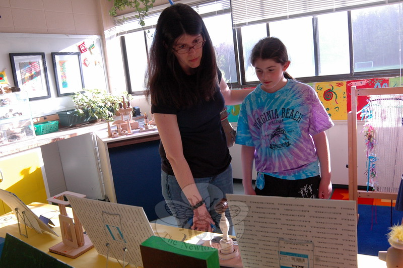 Audra Russo and her daughter Adriana, a fourth grader at Sandy Hook Elementary School, made their way around the school's art room, where many student artworks were on display during the school's  Student Art Show on Thursday, May 7. (Hallabeck photo)