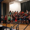 Hawley Elementary School fourth grade students, led by music teacher Brian Kowalsky, left, played a song on their recorders during the school's Spring Concert assembly, held on Monday, May 4. (Hallabeck photo)