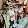 Sandy Hook School fourth grader Stephen Cook, left, dressed as a Star Wars character to represent contemporary music during a performance for the fourth grade's Spring Concert assembly on Wednesday, May 13. (Hallabeck photo)