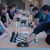 William LeMay, left, and Brendan Gregory faced off in the first round of Newtown High School's Open Chess Tournament, held on Thursday, May 14. Other contenders in the tournament were situated along the table in the school's cafetorium. (Hallabeck photo)
