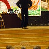"""Larry J. Hunt of the Masque Theatre Company presented a number of masks and information about the different types of masks during an assembly at Head O' Meadow Elementary School on Friday, April 24. """"People like us have been making masks all throughout history,"""" Mr Hunt told the students seated in the school's cafetorium, after sharing a few different masks at the start of the performance. More information about the Masque Theatre Company is available at masque-theatre.org. (Hallabeck photo)"""