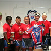 Riders again presented a signed jersey to members of Sandy Hook firefighters. Standing from left is Sandy Hook Engineer Steven Stohl, Minuteman riders Jermaine Bryant, Felipe Chuab, Brian Scholl, John Goodwin, and Bryan Flanery, and Engineer George Lockwood Jr. Behind the men is the jersey that was presented to the fire company in 2013. (Hicks photo)