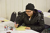 Annual General Meeting of Keewaytinok Native Legal Services held in Moosonee 2014 February 12th. Jamie Wesley reviewing membership applications.