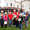 Teen Korps Members delivering roses to seniors