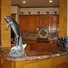 Kitchen Tops and Dolphin-Themed Tile Art in Blue Fusion by Schlitzberger Stone Designs