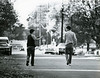 Brothers Danny and Scotty Ritchie pitched a football back and forth as they walked down Daughtony Ave. Saturday.<br /> This photo first published in Nov. 7, 1983, by the Kentucky Standard.