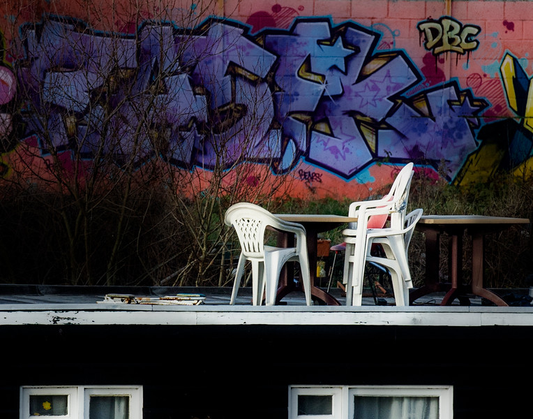Chairs stacked on top of a house boat, await for the return of better weather