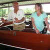 Charles Mistele, left, explains how the seating area of Miss America IX has been modified since the boat was built by Gar Wood in 1930. At right is Kirsten Johnson, whose grandmother was Gar Wood's sister. Johnson has been researching her family history for nearly two years, and paid Mistele a visit to learn what she could about her great-uncle's racing expoits and boat building business. Miss America IX is on display at the ACBS Blue Ridge Chapter's 27th Annual Lake Chatuge Rendezvous through Sunday, June 8, 2014.