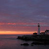 20 Apr 2014 BostonCape Elizabeth, ME-The sun rises to the east of Portland Headlight in Fort Williams Park.
