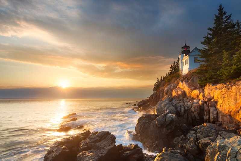 Bass Harbor Head Lighthouse in Acadia National Park in Tremont, Maine at sunset.