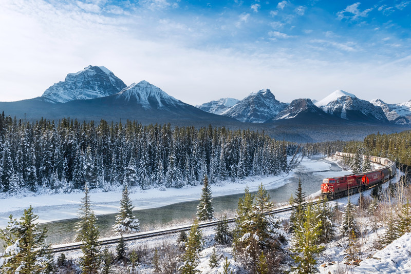 A Canadian Pacific train cuts through the Canadian Rockies in Banff National Park in Alberta, Canada.