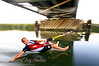 Barefoot waterskiier skiming under Hwy 4 Old River Bridge Discovery Bay