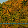 Blue skies and resplendent autumn colors encircle a fisherman on Indian Lake within Indian Lake County Park (USA WI Cross Plains; Obst FAV Photos 2012 Nikon D300s Image 3616