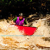 Whitewater solo open canoeist Charles Frisk surfing the upper reversal or souse hole of gorgeouis Tea Kettle or Upper Dalles Rapids at a river flow of 744 CFS on the wild Wolf River Section 4 within Menominee Indian Nation  (USA WI Keshena)