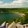 Hiker's view of blue skies over turquoise Devils Lake and quartzite boulder fields along East Bluff Trail within Devils Lake State Park (USA WI Baraboo)