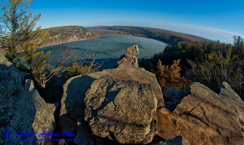 Hiker's springtime view from West Bluff Trail of late day golden sunlight highlighting the southern part of ice covered Devil's Lake and radiant bluffs within Devils Lake State Park (USA WI Baraboo; Obst FAV Photos 2013 Nikon D800 Landscapes Inspirational Image 8830)