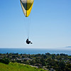 Paraglider floats above California Coast