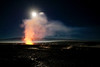 Moon behind vapor plume from Halema'uma'u; Mauna Loa in the distance, lava in the foreground. Big Island, Hawaii.