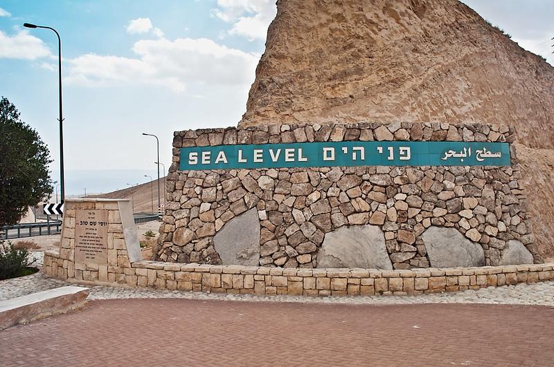 """Highway built in the valley of the Dead Sea in Israel. On the side of a highway sign """"Sea Level"""""""