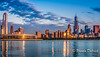 Sunrise Reflecting on Chicago Skyline