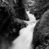 As the water rushes by, this double waterfall cools the surrounding area in Black and white