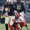 Danny Etling (5) tries to escape from Houston Bates (55) of Illinois