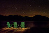 It was a cool fall evening in the Adirondacks, NY (Elk Lake Lodge).  The stars were brilliant with the big dipper right over the horizon.  The Adironack chairs were out on the dock for anyone to sit and enjoy the peaceful, brilliant night.