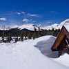Spring snowdrifts engulf the shelter at Brainard lake; Colorado Indian Peaks Wilderness.