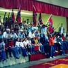 Crowd sitting on the stage at the Berrien-Cook basketball game on Feb. 9, 2001.  This was the next to last night of games in the old gym.<br /> <br /> The Berrien Press, February 14, 2001<br /> photo caption:<br /> REBEL ROUSERS!! The Berrien High gym was packed to capacity like days of old last Friday night, as the Rebels played host to Cook County.  Berrien's student body turned out in force to root on the Rebels against the Hornets in the next to last night of games at the Wilson Metts gymnasium.  Berrien travels to Waycross this weekend for the Region 2-AA Tournament.