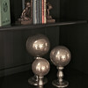 These gold glass orb finials have a molten look to them with ripples of gold flecks beneath the surface of the glass.