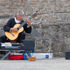 SAINT-MALO, FRANCE - JULY 6: Guitarist Jean Paul Albert playing classical guitar in Saint-Malo, France on July 6, 2011. He plays on a guitar with ten strings.