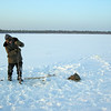 Ice-fisherman defying -30º Celsius conditions on West Siberia lake, Russia