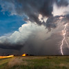 A weak thunderstorm at dusk puts down a lucky cloud-to-ground lightnong bolt only about a mile in front of the photographer. Shot near Lexington, OK, on July 11, 2013.