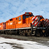 Group of four heavy diesel north American locomotive in winter against a cloudy sky