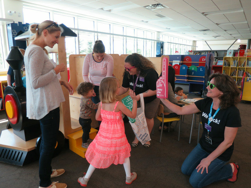 Tina and Jennifer celebrate with young patrons in the LHL Children's area