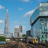A London Charing Cross bound Southeastern train arrives at Waterloo East Station under the Shard. The 1,004 ft Shard is currently the tallest building in the European Union.