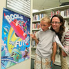 A family enjoys the scavenger hunt at the Summer Reading Club Opening Celebrations at LON, June 28 2014.