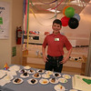 A volunteer serves cake at EPL's 101st birthday at LON, March 13 2014.