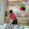 A volunteer cuts cake at EPL's 101st birthday at LON, March 13 2014.
