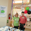 Circulation Assistant Angela Resendes and a volunteer serve cake at EPL's 101st birthday at LON, March 13 2014.
