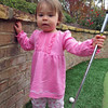 Lorelei knocking down Nanu's golf clubs ... again!