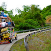 "Typical mode of transportation in the Philippines is the colorful Jeepney. I find this one particularly fun since the picture shows it's way overloaded with goods, it's tilting on one side, people are riding it from the roof, its going through a steep curve and with all that, the slogan at the back of the Jeepney says ""STAYING ALIVE""."