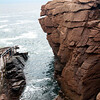"""Thunder Hole, named for the loud booming made when water is forced with in coming tide upward and through the narrow gut of rocks, a famous feature of Acadia National Park area, Mount Desert Island, Maine in September, an iconic popular tourist destination. I call this image """"The Balancing Man."""""""