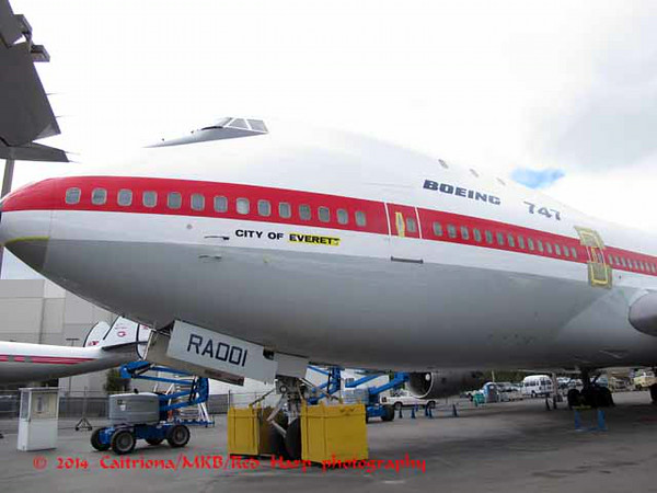 "the nearly done side.  It still needs the decals of the insignia of the airlines that placed the first order for 747's.  They are also going to repaint the name of the aircraft, ""City of Everett"""