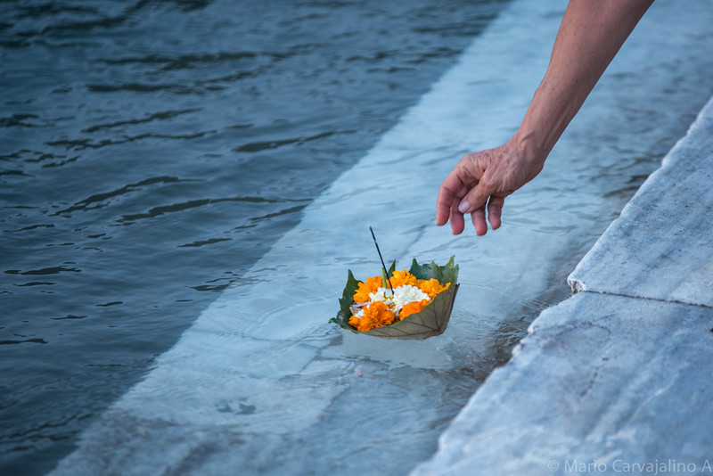PRAYER IN THE GANGES RIVER, INDIA